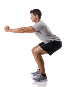 Athletic man running doing squats