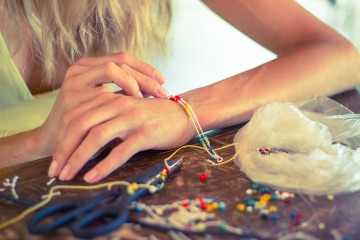 Woman making diy jewelry
