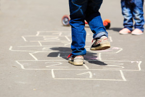 kid playing on diy hopscotch game