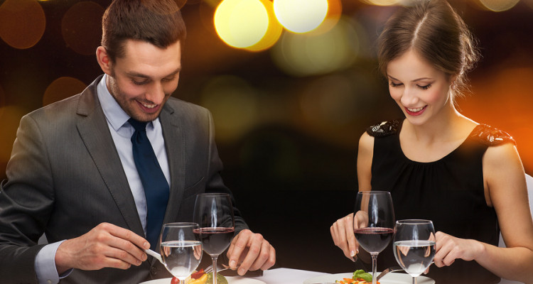 man and woman eating in affordable restaurant