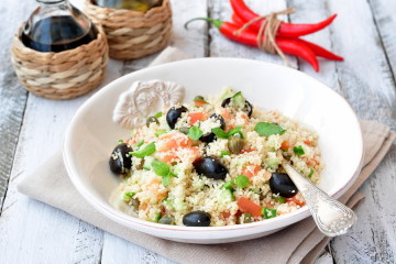 Easy vegetarian salad from a couscous with vegetables and olives