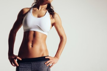 exercising woman with good abs