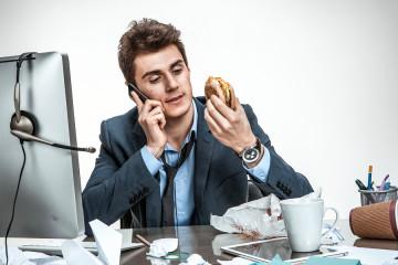 Man eating at work